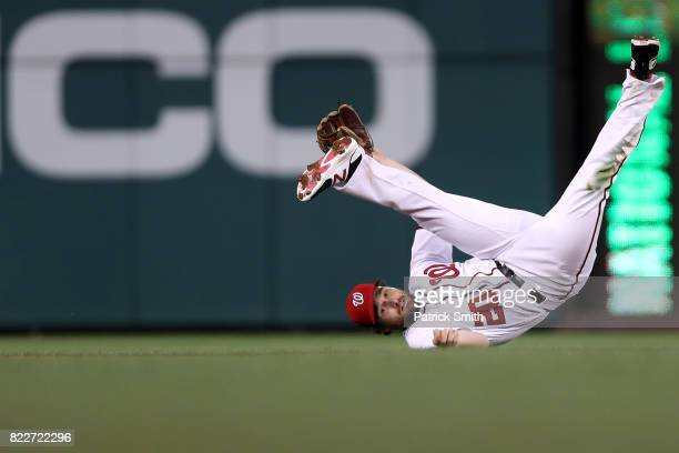 Daniel Murphy of the Washington Nationals cannot make a play to second base against the Milwaukee Brewers during the fourth inning at Nationals Park...
