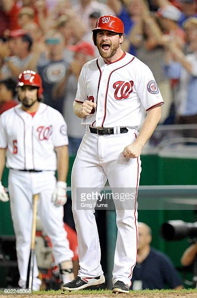 Daniel Murphy of the Washington Nationals celebrates after scoring in the eighth inning against the Philadelphia Phillies at Nationals Park on...