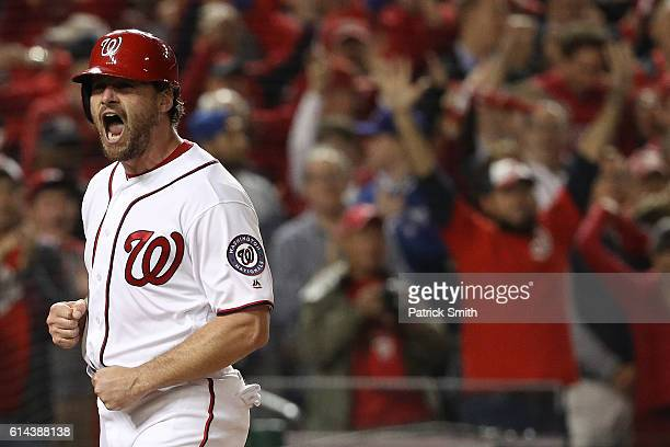 Daniel Murphy of the Washington Nationals celebrates after scoring off of an RBI single hit by Danny Espinosa of the Washington Nationals in the...