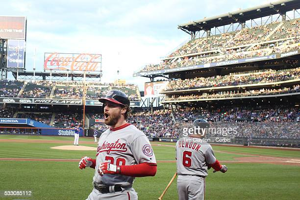 Daniel Murphy of the Washington Nationals celebrates as he returns to the dugout after hitting a two run home run off Matt Harvey of the New York...