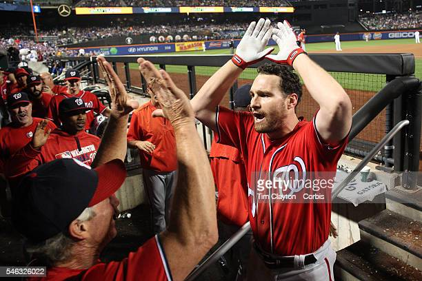 Daniel Murphy of the Washington Nationals celebrates his two run home run in the seventh inning on his return to the dugout during the Washington...
