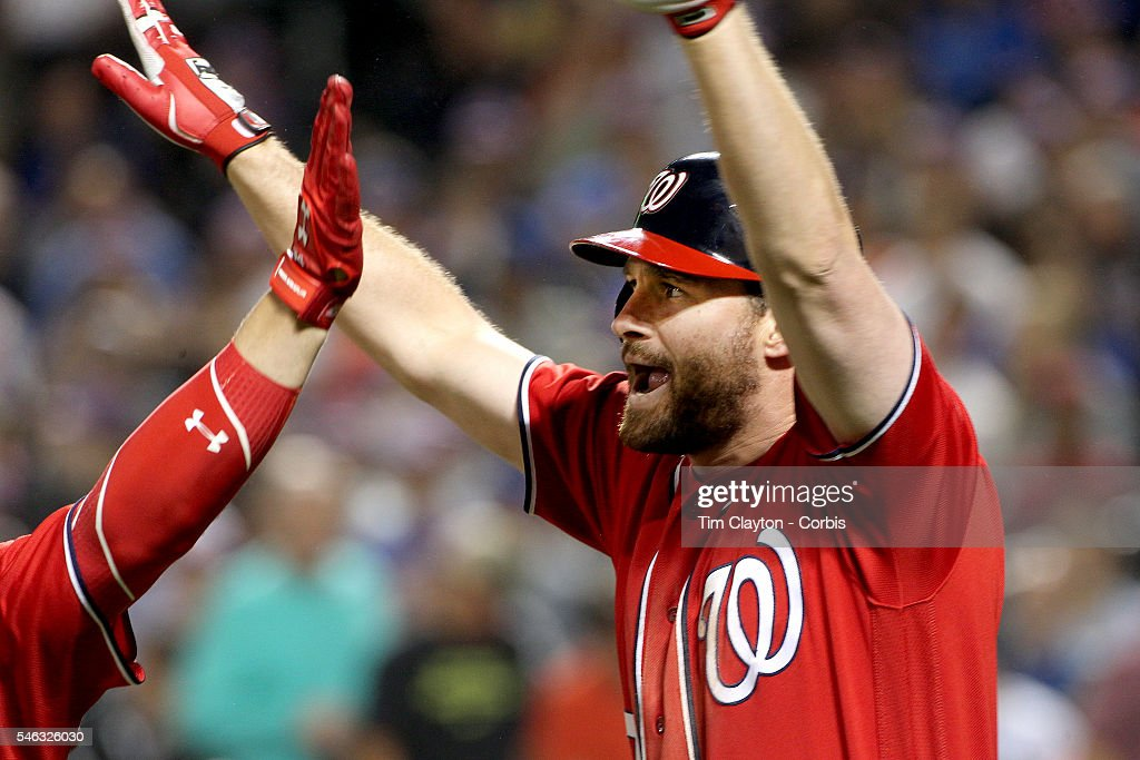 Daniel Murphy of the Washington Nationals celebrates his two run home run in the seventh inning with Bryce Harper of the Washington Nationals during...