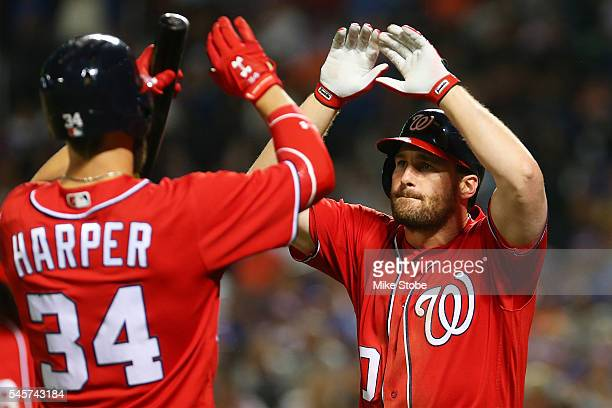 Daniel Murphy of the Washington Nationals celebrates with Bryce Harper after hitting a two run home run in the seventh inning against the New York...