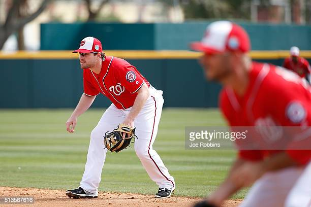 Daniel Murphy of the Washington Nationals fields against New York Mets in the first inning of a spring training game at Space Coast Stadium on March...