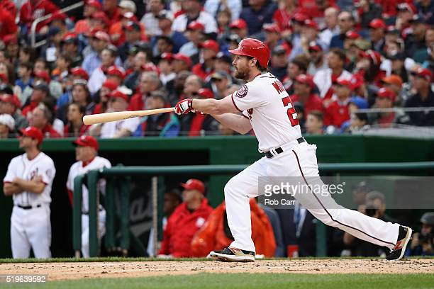 Daniel Murphy of the Washington Nationals follows his three RBI triple in the first inning against the Miami Marlins during the Nationals home opener...