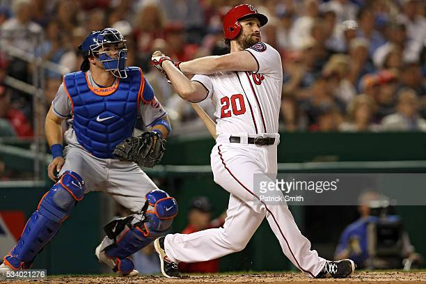 Daniel Murphy of the Washington Nationals follows through on his two run home run against the New York Mets during the fifth inning at Nationals Park...