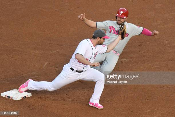 Daniel Murphy of the Washington Nationals forces out Brock Stassi of the Philadelphia Phillies at second base during game two of baseball game at...
