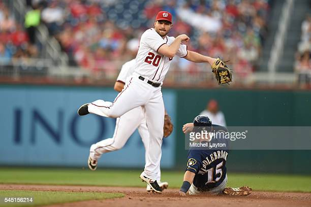 Daniel Murphy of the Washington Nationals forces out Will Middlebrooks of the Milwaukee Brewers on a double lay ball hit by Ramon Flores in the...