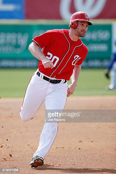 Daniel Murphy of the Washington Nationals heads toward third base on his way to scoring a run against the New York Mets after a single by Anthony...