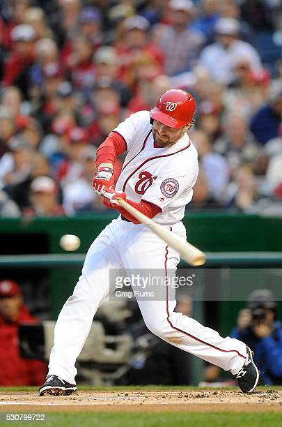 Daniel Murphy of the Washington Nationals hits a single in the first inning against the Detroit Tigers at Nationals Park on May 11 2016 in Washington...