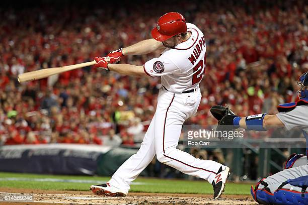 Daniel Murphy of the Washington Nationals hits a single in the second inning against the Los Angeles Dodgers during game five of the National League...