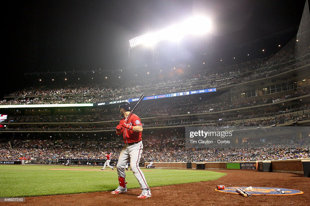 Daniel Murphy of the Washington Nationals hits a two run home run in the seventh inning as Bryce Harper of the Washington Nationals waits on deck...