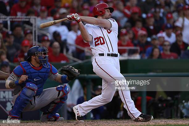 Daniel Murphy of the Washington Nationals hits an RBI single in the seventh inning against the Los Angeles Dodgers during game two of the National...