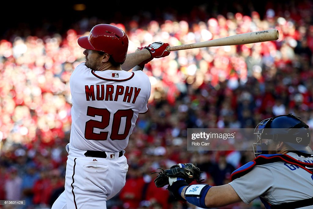 Daniel Murphy #20 of the Washington Nationals hits an RBI single in the seventh inning against the Los Angeles Dodgers during game two of the National League Division Series at Nationals Park on October 9, 2016 in Washington, DC.