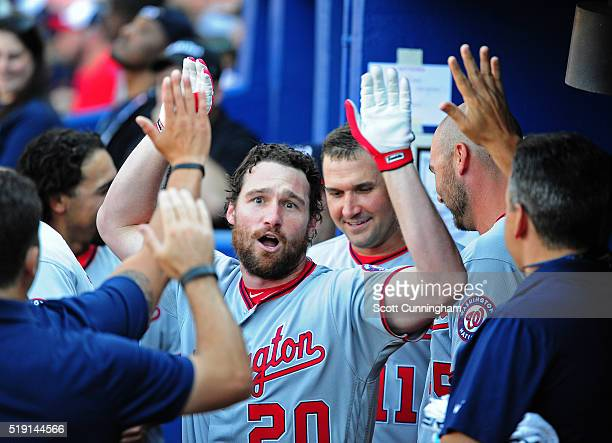 Daniel Murphy of the Washington Nationals is congratulated by teammates after hitting a fourth inning solo home run against the Atlanta Braves at...
