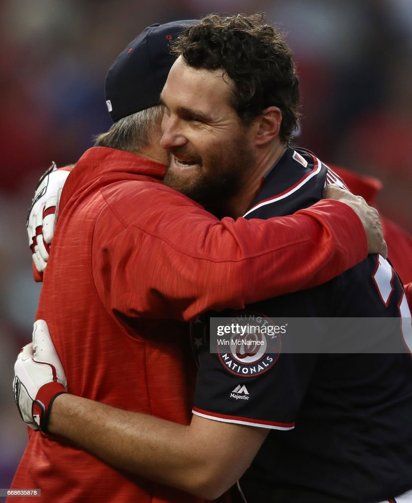 Daniel Murphy #20 of the Washington Nationals is congratulated by one of his coaches after Murphy hit a game winning double in the tenth inning against the Philadelphia Phillies on April 14, 2017 at Nationals Park in Washington, DC. The Nationals won the game 3-2.