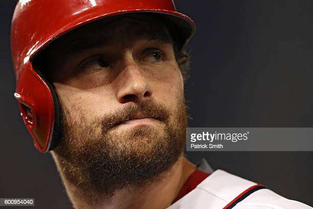 Daniel Murphy of the Washington Nationals looks on after hitting a sacrifice RBI during the eighth inning against the Philadelphia Phillies at...