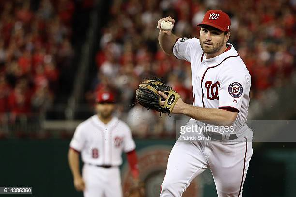 Daniel Murphy of the Washington Nationals makes a throw to first base for the second out of the second inning against the Los Angeles Dodgers during...
