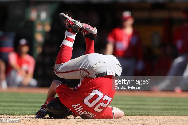 Daniel Murphy of the Washington Nationals reacts after being hit by a pitch during the ninth inning of the MLB game against the Oakland Athletics at...