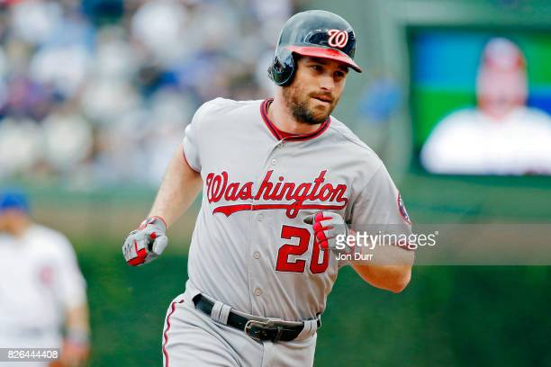 Daniel Murphy of the Washington Nationals rounds the bases after hitting a home run against the Chicago Cubs during the sixth inning at Wrigley Field...