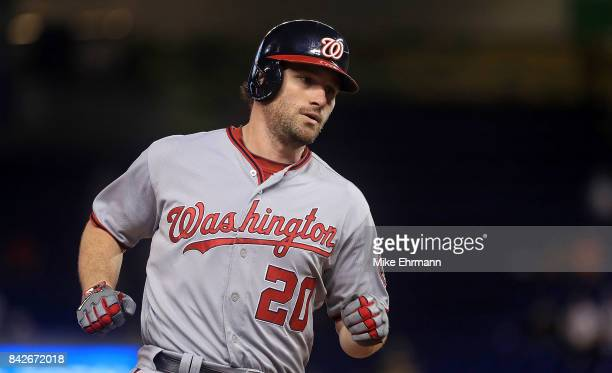 Daniel Murphy of the Washington Nationals rounds the bases after hitting a solo home run during a game against the Miami Marlins at Marlins Park on...