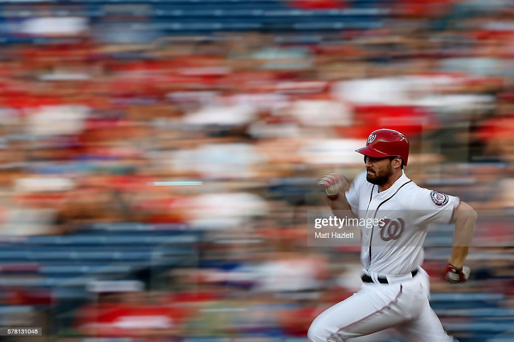 Daniel Murphy of the Washington Nationals runs to second base after hitting a double in the first inning against the Los Angeles Dodgers at Nationals...