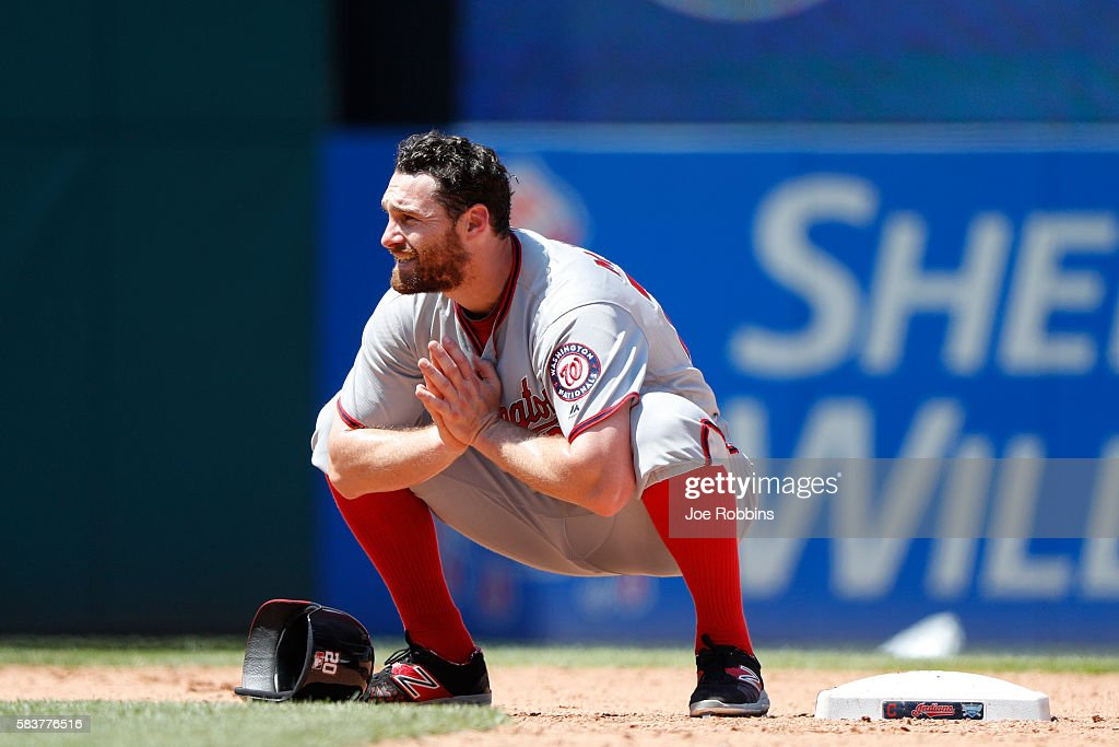 Daniel Murphy of the Washington Nationals stretches while waiting at second base during a pitching change in the eighth inning against the Cleveland...