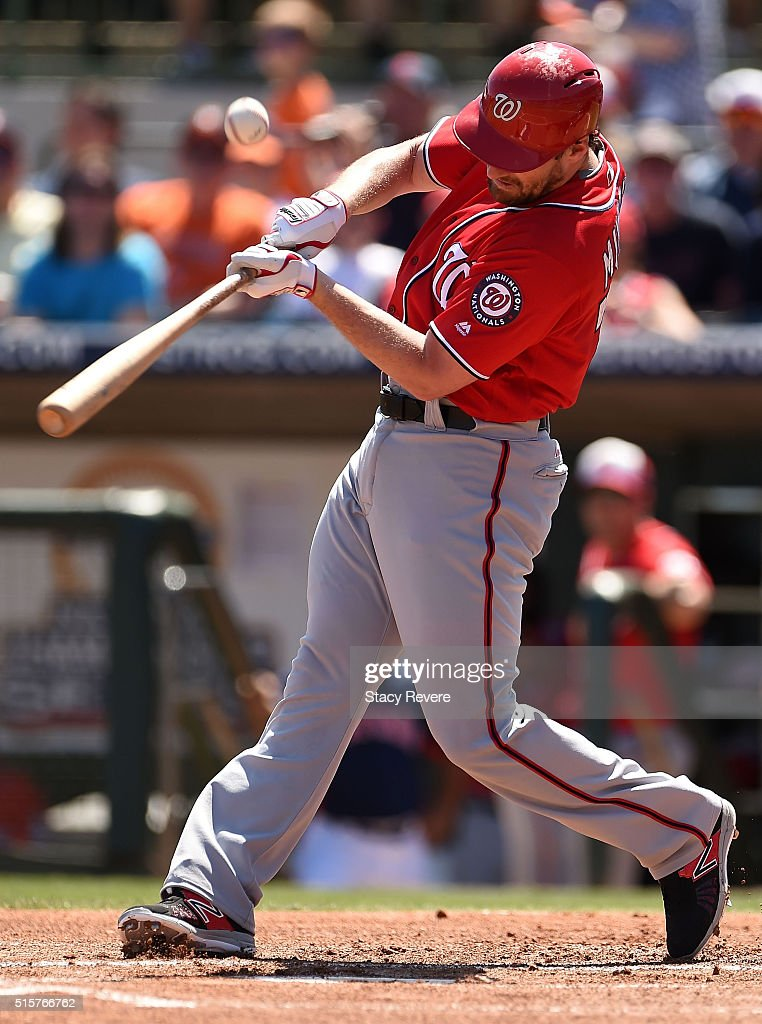 Daniel Murphy of the Washington Nationals swings at a pitch during a spring training game against the Houston Astros at Osceola County Stadium on...