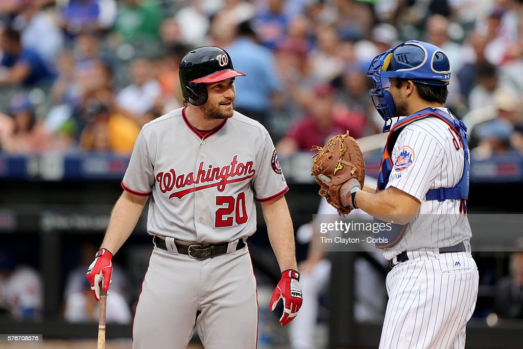 Daniel Murphy of the Washington Nationals talking with catcher Travis d'Arnaud of the New York Mets while batting during the Washington Nationals Vs...