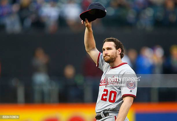 Daniel Murphy of the Washington Nationals tips his cap to the fans before a game against the New York Mets at Citi Field on May 17 2016 in the...
