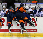 Daniel MuzitoBagenda of the Mississauga Steelheads is hit by Cullen Mercer and Bryce Yetman of the Flint Firebirds during OHL game action on October...