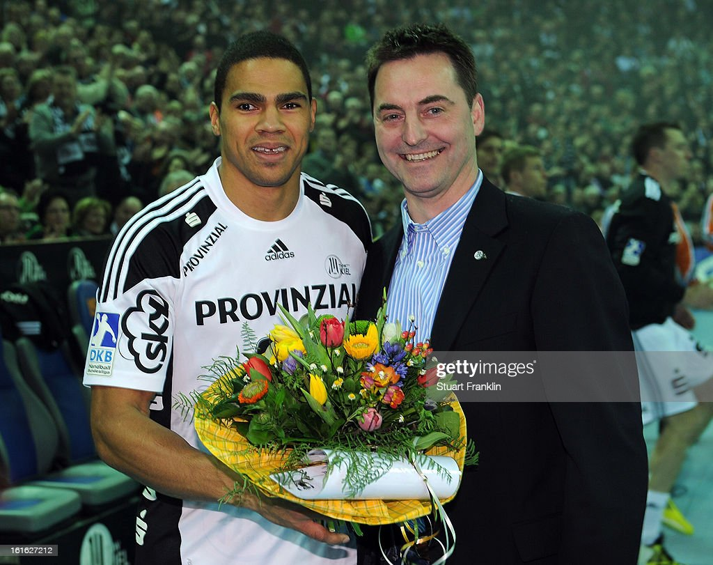 Daniel Nacisse of Kiel is presented with some flowers in recognition of being named world player of the year prior to the start of the HBL Bundesliga game between THW Kiel and TSV Hannover-Burgdorf at the Sparkassen arena on February 13, 2013 in Kiel, Germany.