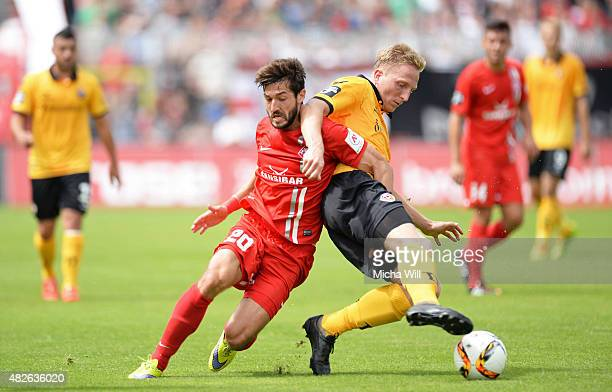 Daniel Nagy of Wuerzburg and Marco Hartmann of Dresden tussle for the ball during the Third League match between Wuerzburger Kickers and Dynamo...