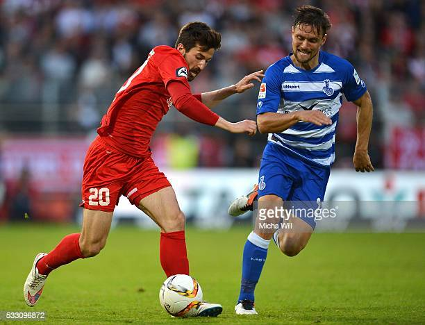 Daniel Nagy of Wuerzburg is challenged by James Holland of Duisburg during the Second Bundesliga Play Off first leg match between Wuerzburger Kickers...
