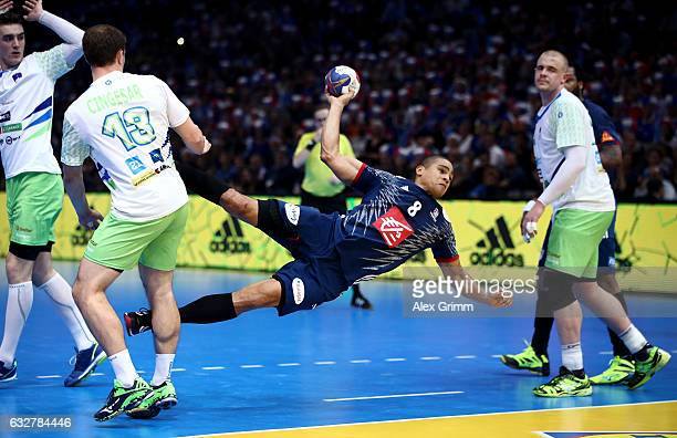 Daniel Narciss of France challenges Darko Cingesar of Slovenia during the 25th IHF Men's World Championship 2017 Semi Final match between France and...