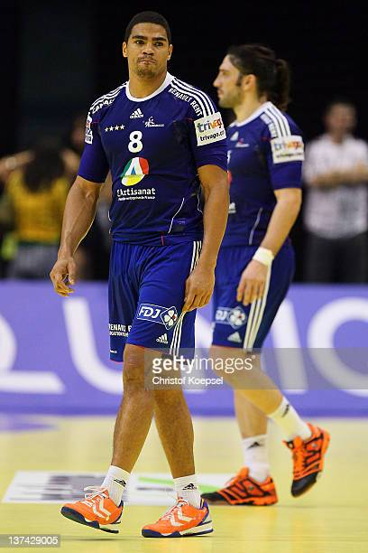 Daniel Narcisse and Bertrand Gille of France look dejected after losing 2326 the Men's European Handball Championship group C match between France...