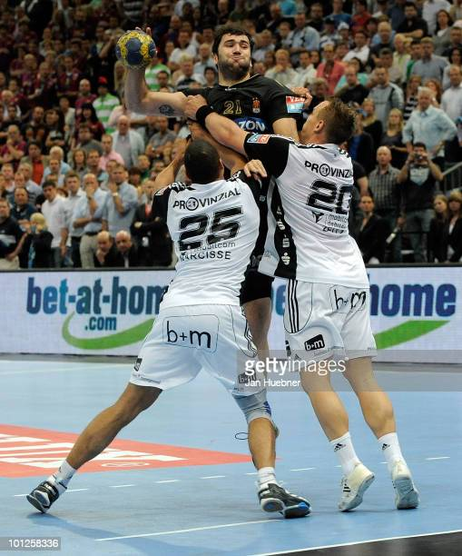 Daniel Narcisse and Christian Zeitz of THW Kiel try to block Joan Canellas of Ciudad Real during the handball semi final match between Ciudad Real...