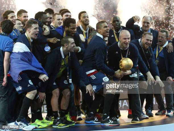 Daniel Narcisse and goalkeeper of France Thierry Omeyer hold the trophy and celebrate with teammates the victory following the 25th IHF Men's World...