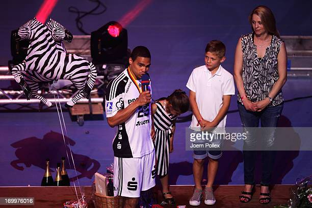 Daniel Narcisse and his family say goodbye to the fans as the players of THW Kiel present the Bundesliga trophy to the fans at the Sparkasse Arena on...
