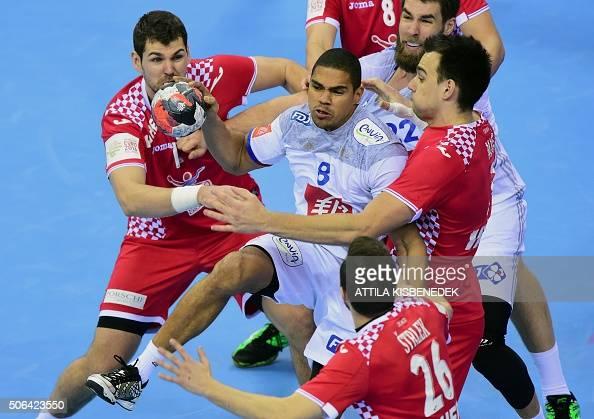 TOPSHOT Daniel Narcisse and his teammate Luka Karabatic of France fight for the ball with Jakov Gojun Marino Maric and Manuel Strlek of Croatia...