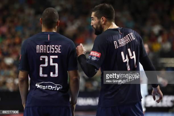 Daniel Narcisse and Nikola Karabatic of Paris react during the VELUX EHF FINAL4 final between Paris SaintGermain Handball and HC Vardar at Lanxess...