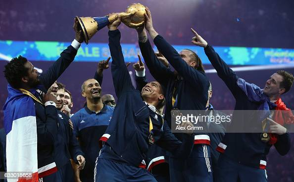 Daniel Narcisse and team mates of France lift the trophy after victory during the 25th IHF Men's World Championship 2017 Final between France and...