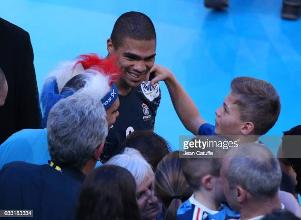 Daniel Narcisse of France celebrates the victory with his family following teammates the victory following the 25th IHF Men's World Championship 2017...