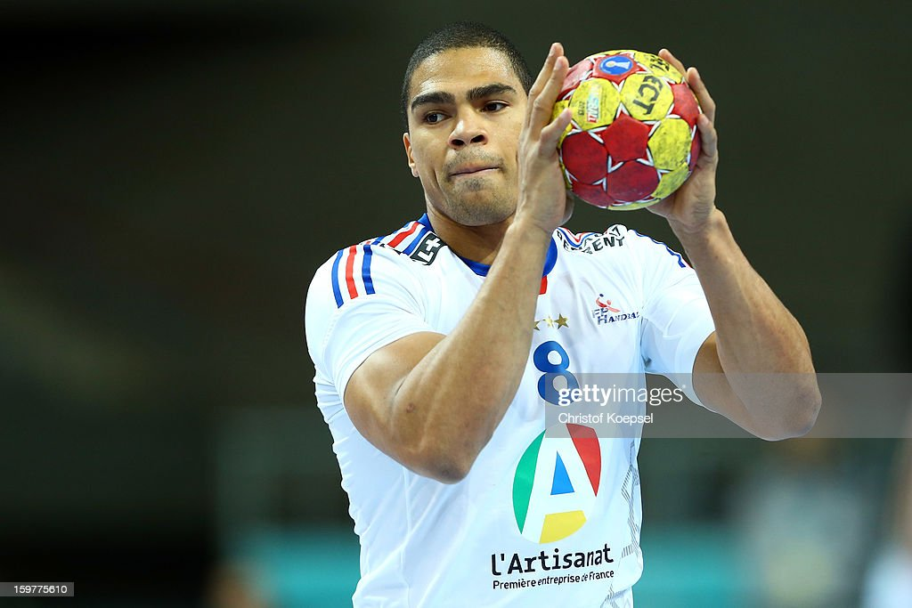 Daniel Narcisse of France passes the ball during the round of sixteen match between Iceland and France at Palau Sant Jordi on January 20, 2013 in Barcelona, Spain.