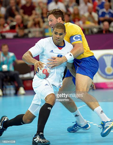 Daniel Narcisse of France with Tobias Karlsson of Sweden during the Men's Handball Gold Medal Match on Day 16 of the London 2012 Olympic Games at...