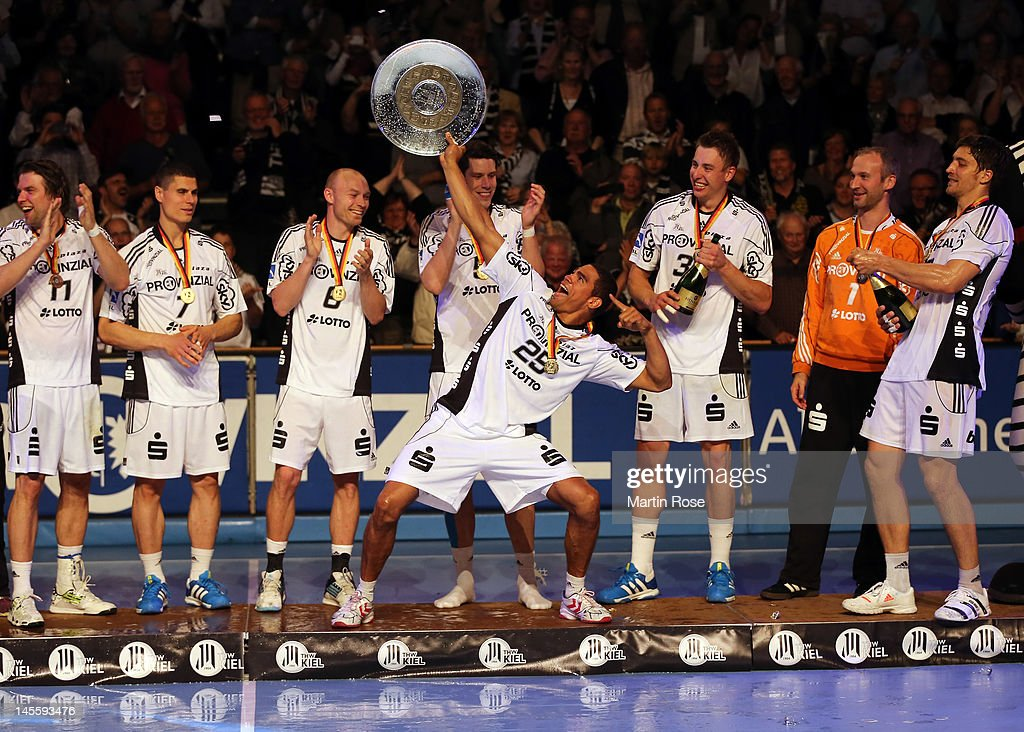 <a gi-track='captionPersonalityLinkClicked' href=/galleries/search?phrase=Daniel+Narcisse&family=editorial&specificpeople=791032 ng-click='$event.stopPropagation()'>Daniel Narcisse</a> of Kiel celebrate lifts the trophy after winning the german handball championship after the Toyota Handball Bundesliga match between THW Kiel and VfL Gummersbach at Sparkassen Arena on June 2, 2012 in Kiel, Germany.