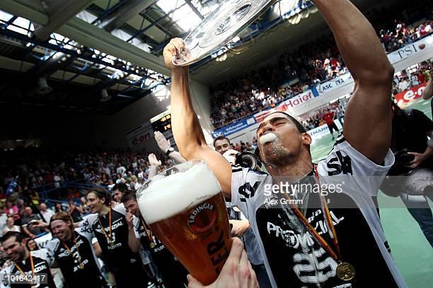 Daniel Narcisse of Kiel celebrates after the Toyota Handball Bundesliga match between TV Grosswallstadt and THW Kiel at the Frankenstolz Arena on...
