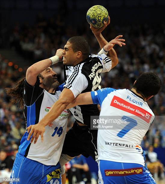 Daniel Narcisse of Kiel challenges for the ball with Bertrand Gille and Matthias Flohr of Hamburg during the Bundesliga match between HSV Hamburg and...