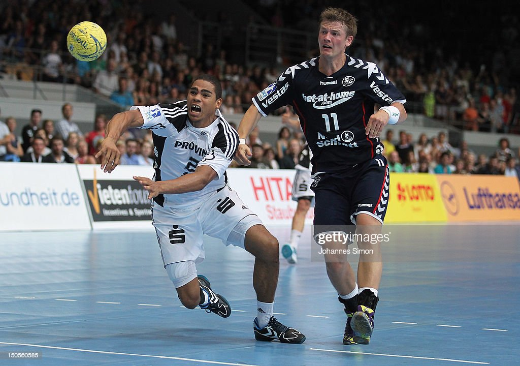 <a gi-track='captionPersonalityLinkClicked' href=/galleries/search?phrase=Daniel+Narcisse&family=editorial&specificpeople=791032 ng-click='$event.stopPropagation()'>Daniel Narcisse</a> (L) of Kiel is challenged by Lasse Svan Hansen of Flensburg during the Handball Supercup match between THW Kiel and SG Flensburg Handewitt at Olympia Eishalle on August 21, 2012 in Munich, Germany.