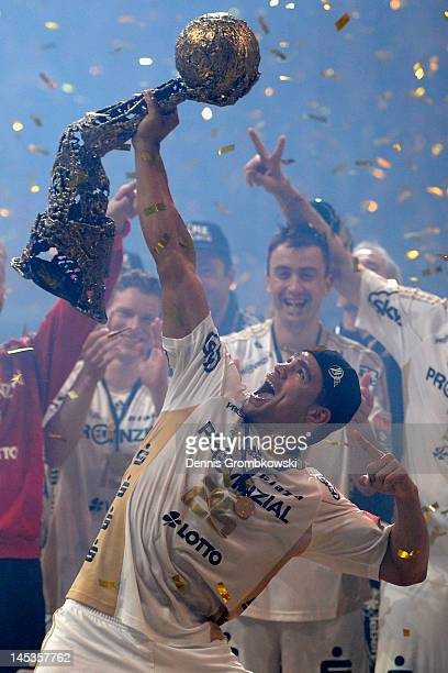 Daniel Narcisse of Kiel lifts the trophy after the EHF Final Four final match between THW Kiel and BM Atletico Madrid at Lanxess Arena on May 27 2012...